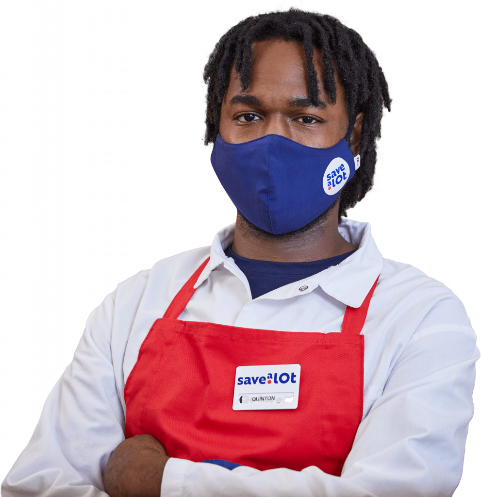 Save a lot meat cutter with blue face mask and red apron
